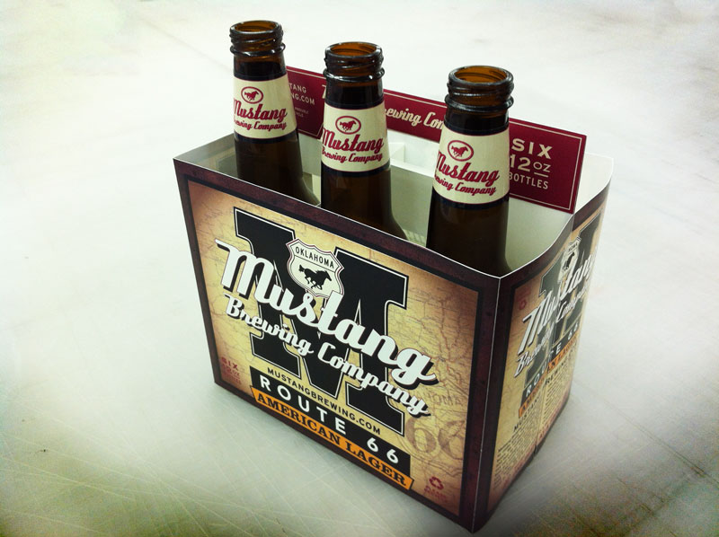 a mockup proof of a six pack of beer with three bottles