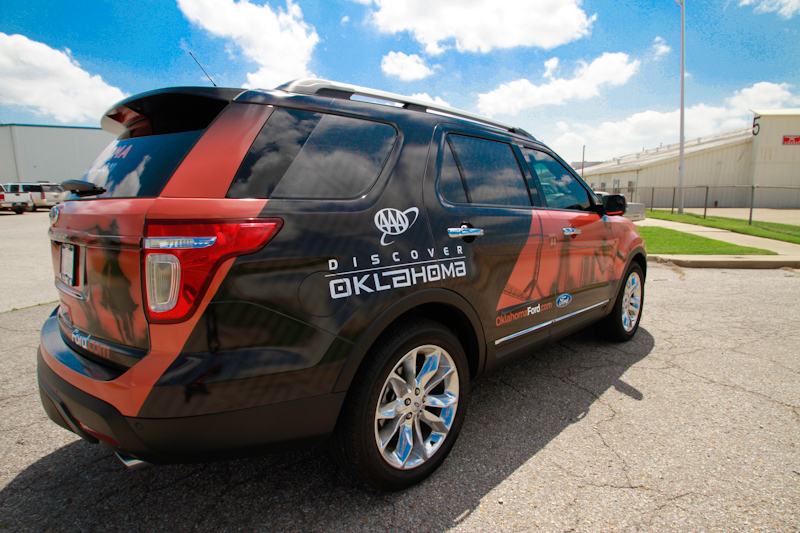 A custom vehicle wrap for the Oklahoma Tourism and Recreation Department on a Ford Explorer
