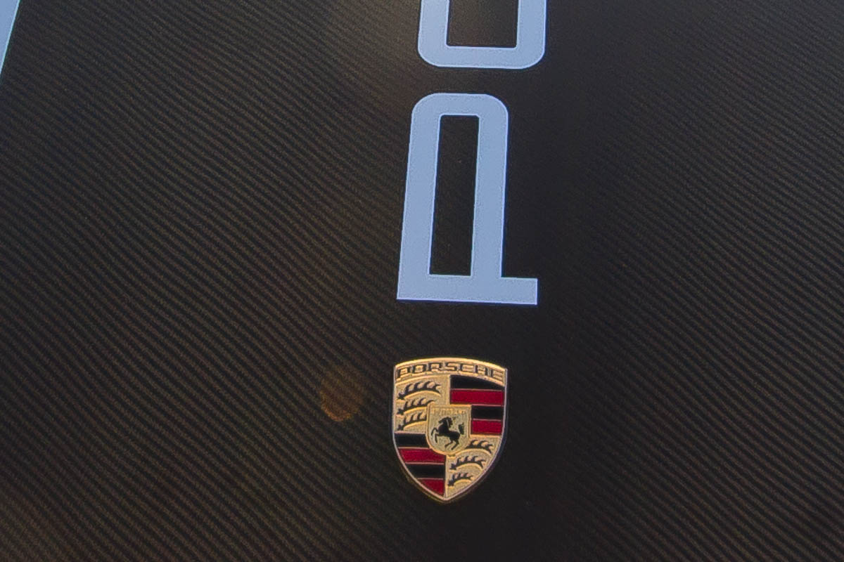 Closeup of hood stripe made of carbon fiber vinyl on a Porsche Carrera 996