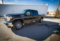 Mossy Oak camouflage wrap on the rocker panels of a Ford F-250. Three quarters view.