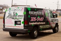 A black and white van wrap with colored paint drops for Exceptional Carpet Cleaning