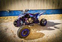 A quad racer with custom vehicle wrap graphics.
