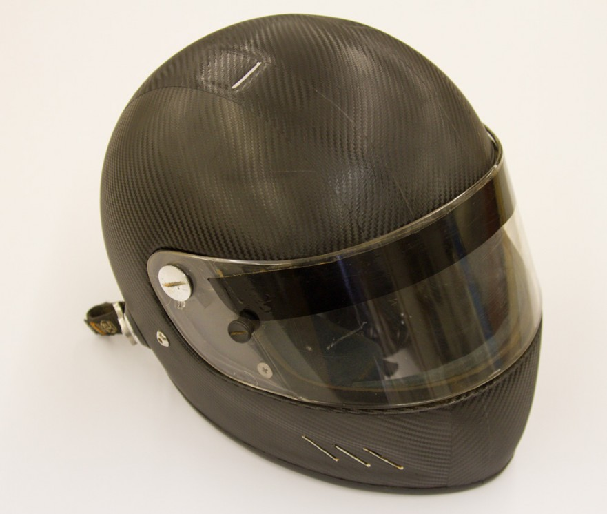A racing helmet that has been wrapped in 3M 1080 dinoc carbon fiber wrap material