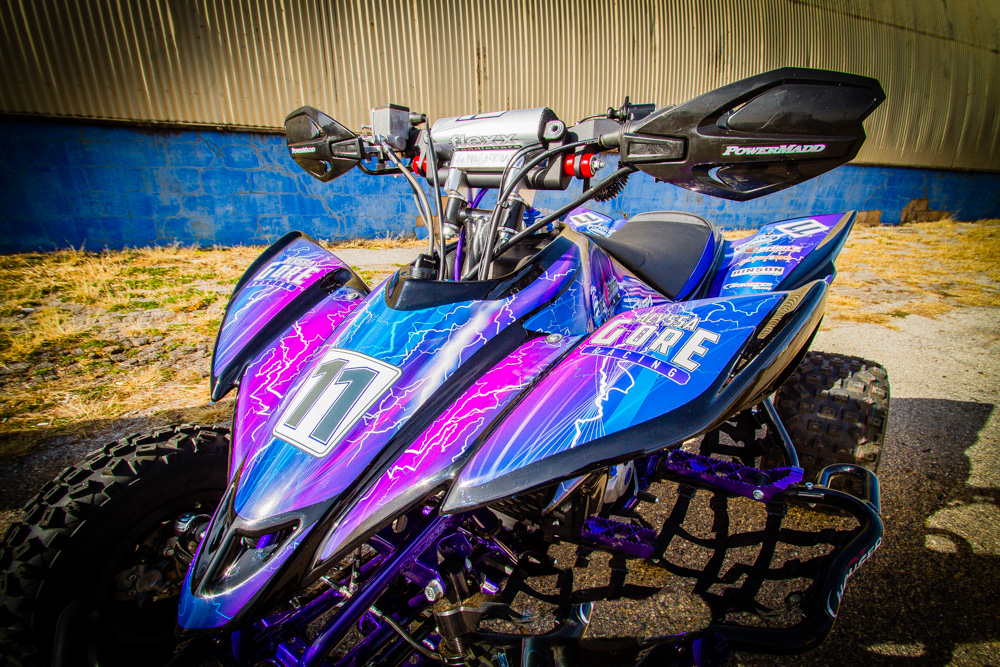 A closeup of a quad racer with custom wrap graphics.