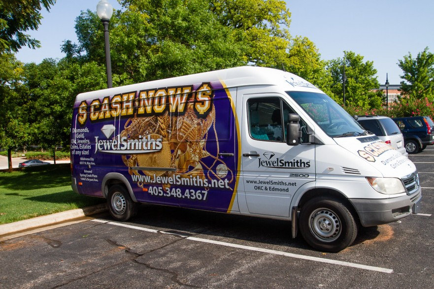 Sprinter Van with gold and purple wrap design